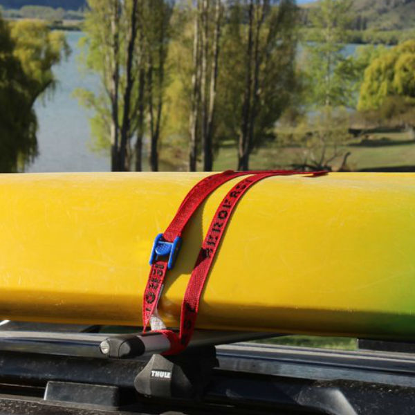 Aerofast tie down straps securing kayak to a cars roof rack